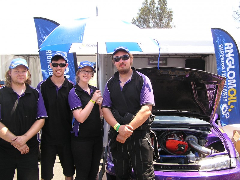 Driver Simon Michelmore (extreme right) and his support crew at the Sydney round